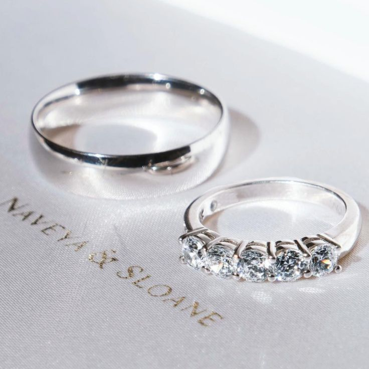 The Five Stone Claw Set Diamond Band, and the Beveled Half Round Band. Naveya & Sloane wedding bands, made to order in Auckland, New Zealand.