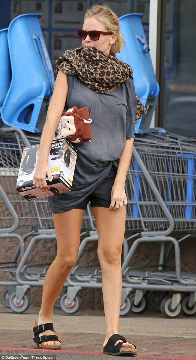 Effortlessly chic: The model wore a loose grey blouse teamed with matching shorts that sho...