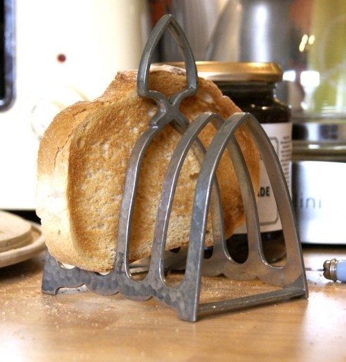 Antique Victorian Pewter Toast Rack. Earliest examples from 1770s. Made in large quantities still today. Maintaining air gaps between slices allows steam to escape from hot toast instead of condensing into adjacent slices & making them soggy. Increased air flow also means toast becomes cold more quickly. A designer known for his innovative take on the toast rack was Christopher Dresser (1834–1904), who studied at the Government School of Design in Glasgow from age 13 ~ You were dying to know…
