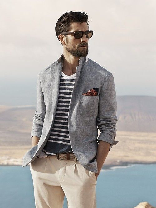 Shop this look on Lookastic: http://lookastic.com/men/looks/blazer-and-pocket-square-and-chinos-and-sunglasses-and-crew-neck-t-shirt-and-belt/2979 — Grey Cotton Blazer — Brown Polka Dot Pocket Square — Beige Chinos — Dark Brown Sunglasses — White and Navy Horizontal Striped Crew-neck T-shirt — Tan Woven Canvas Belt