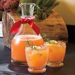 Rudolph's Tipsy Spritzer     5 cups orange juice  2 cups chilled lemon-lime soft drink  1 1/2 cups vodka  1/2 cup maraschino cherry juice 1/4 cup fresh lemon juice  Garnishes: lemon slices, fresh rosemary sprigs