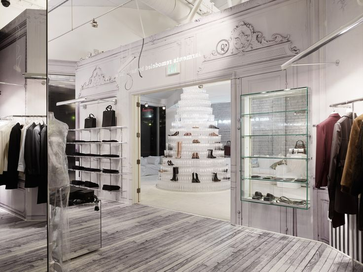 A giant crystal cake made of shoes in the middle of the for Boutique interior design