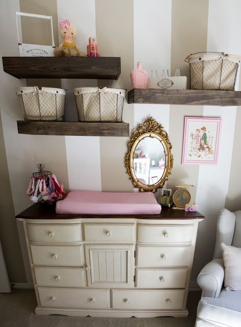 Baby girl nursery wall. Love the baskets for extra storage and the decoration above the crib. Adorable!