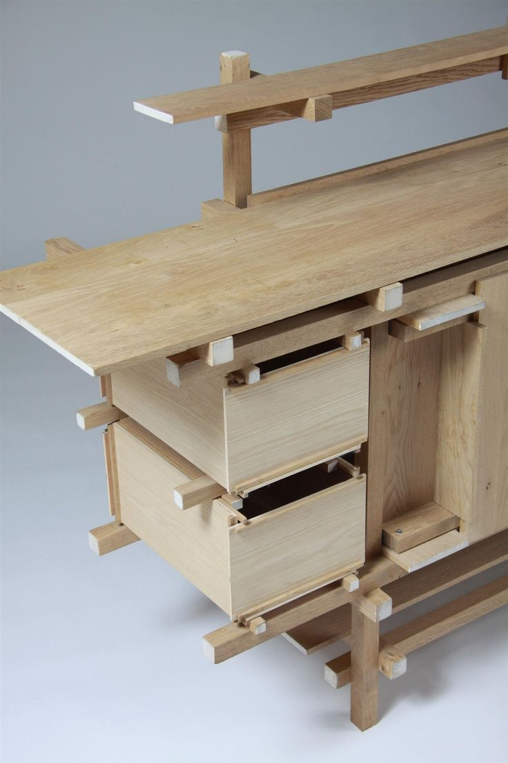 Elling. Designed by Gerrit Rietveld, Holland. 1919.  The original was only produced for the Elling house, and was subesequently destroyed in a fire. This example of later production, 1980's or 1990's, in solid oak with white painted ends.