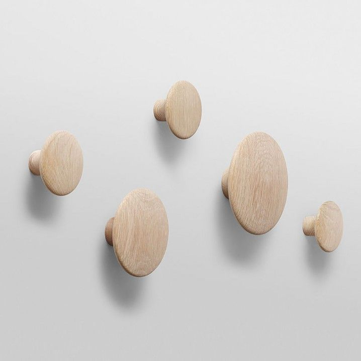 The DOTS, designed by Lars Tornøe, have become a design icon. Produced from high quality wood, The DOTS sculptured design can be arranged on the wall in exactly the pattern and colour combination that is desired. They are very versatile and can be used in multiple settings, including the entrance hall, bedroom and kitchen.  Material: First class oiled oak and ash wood (coloured versions in ash wood)  Cleaning instructions: Clean with moist cloth  Small: Diameter: 9 cm Depth: 3,5 cm...