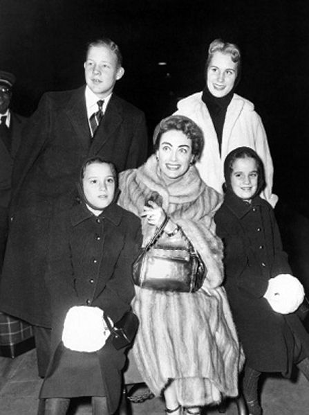 Joan Crawford and her children,Chris,Christina and twin daughters 1955 departing for a European vacation on board the Queen Mary