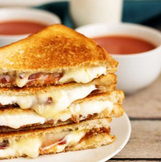 Our grown up bacon grilled cheese sandwich takes your old fashioned grilled cheese and dresses it up with bacon, brie, muenster, and mozzarella cheeses.