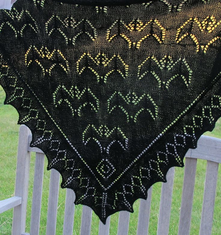 Free Knitting Pattern for Bat Shawl - Lace triangle shawl featuring lace bat motifs designed by Emilee Mooney. Pictured project by mer