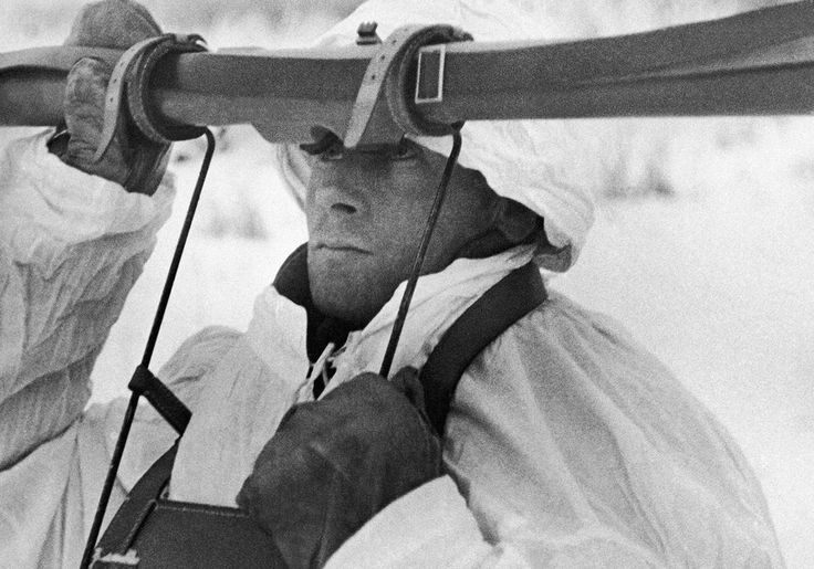 On November 30, 1939, after Soviet demands made to Finland went unmet - they were asking the Finns to give them land concessions and to destroy fortifications along the border - the USSR invaded Finland. Some 450,000 Soviet soldiers crossed the border, starting a brutal, frozen battle that would be called the Winter War. In this image, a member of a Finnish anti-aircraft detachment, works with a range-finder on December 28, 1939, during a Russian aerial attack.