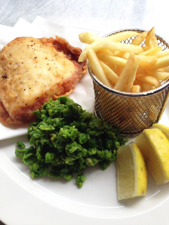 Fish and Chips R 85.00 / ± $8,50 Battered Fish served with Mashy Peas, Crispy Fries, and Herb Mayo To stay at The Hyde Hotel contact us below on the email. phone click the photo 13 London Road Sea Point 8001 Cape Town, Western Cape Always open Phone021 434 0205 Emailreception@thehydehotel.com #Fishing #Aquarium #FlyFishing #Food #Water #Salmon #Recipe #Foodie #Kingklip #fried #oil #peas #mash #chips #slapchips #BatteredFish #healthyeating #Seapoint #hotelrestaurant #restaurant #hotel