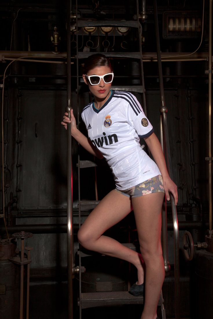 Real Madrid home jersey 12-13. Girl on old industrial machine.