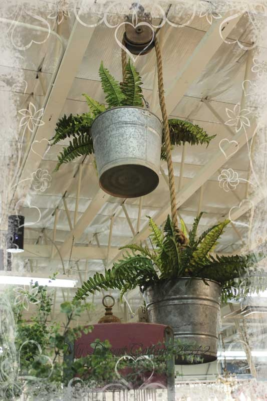 I just did something like this in my garden to add pops of color. Love it. An old pulley and two galvanized buckets what a great idea for the garden