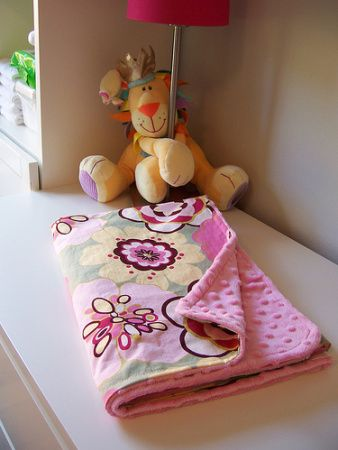 Minky is a little hard to work with, smooth out mat  stretchy...pin it more closely & use a longer st length, decrease tension, sew minky side down