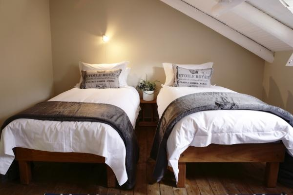 Coetzer House - spacious house sleeping 10 in total. 2 queen bedrooms of which the one has a double sleeper couch. The loft has 4 single beds. The large deck with Jacuzzi and fireplace is perfect for a party.
