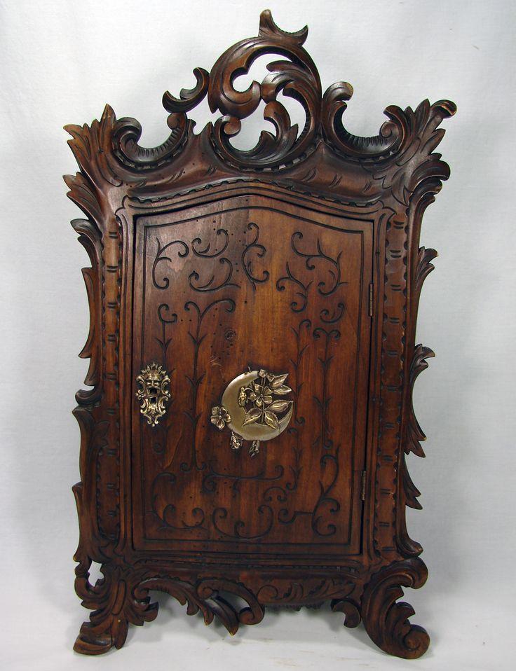 antique hand carved french or black forest wall cabinet superb figural hardware lock key. Black Bedroom Furniture Sets. Home Design Ideas