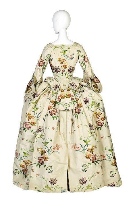 Back view, Mantua, 1740-1750. Cream silk rocaded with polychrome silk in pattern of serpentine floral sprays.