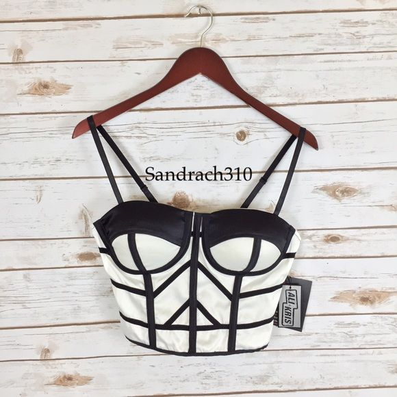 White cropped bustier Brand: Ali&Kris Size:L New Colors:Black and White  Cropped Adjustable straps Spaghetti straps  Sleeveless Smocked back  Padded cups  Sweetheart neck  98%Polyester 2%Spandex Tops Crop Tops