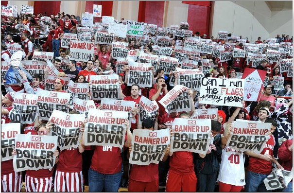 IU Athletics photo of the student section holding up the IDS.
