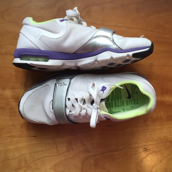 White Nike Trainer Ones These white trainers have a fun flare to them with purple, neon yellow, and silver accents. These shoes are great for the gym or even a court because of their white soles. Nike Shoes Athletic Shoes
