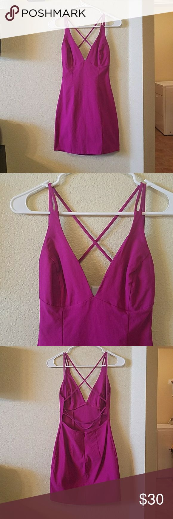 Magenta/purple dress. Criss cross low back, low v front. Very form fitting stretchy material. Perfect condition, purchased from another posher and ended up not wearing for event. Gorgeous dress for a night out! Dresses