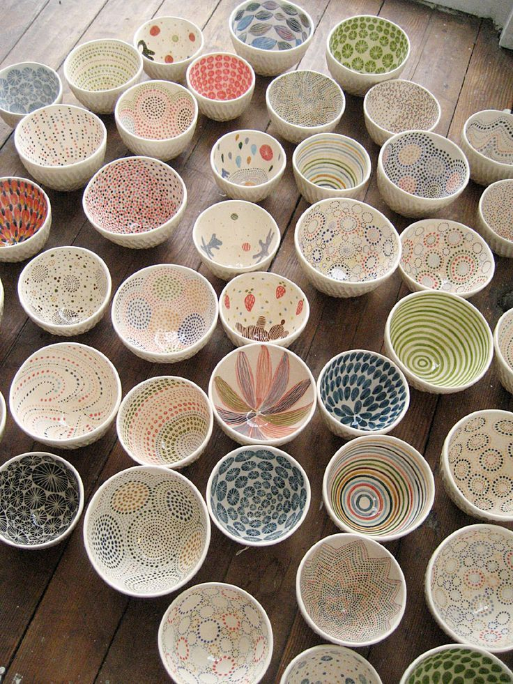LOVE these pottery small bowls with artsy patterns!