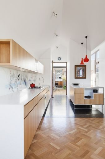 White ceilings contrast with wooden floors throughout this living area