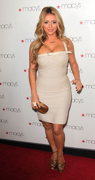 Aubrey O'Day Photos Photos - Actress Aubrey O'Day attends the Macy's Passport Presents Glamorama, Fashion Extravaganza at the Orpheum Theatre  on September 16, 2010 in Los Angeles, California. - Macy's Passport Presents Glamorama, Fashion Extravaganza - Arrivals
