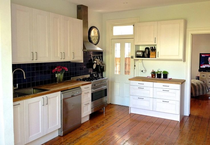 Smart Ideas and Designs for Small Kitchens: Interesting Ikea Small Kitchen Ideas Design Interior 2014 With Countertop Top Cabinet Backsplash Base Cabinet Kitchen Sink Faucet Freestanding Cooker Range Hood Cookware And Wooden Flooring Decors ~ boholmain.com Kitchen Design Inspiration