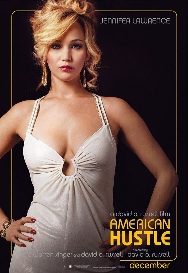 Jennifer Lawrence looks striking in a white cleavage-baring gown complete with a dramatic curled 'do.