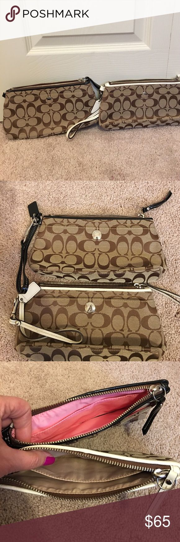 Coach clutched 1- Black and Tan Coach clutch with pink interior. Never used  1- white and tan clutch with cream/light tan interior. Never used.  Selling both for $65 or $45 each. Make me an offer :) Coach Bags Clutches & Wristlets
