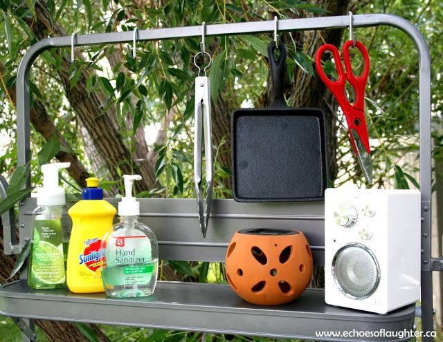 And here are how some other things are organized above the sink, which makes for a simple and functional kitchen. We have the hand soap, dish soap and hand sanitizer ready for washing up all the dirties when needed. A few other camping items are hung here including a small portable radio for listening to tunes while cooking, easy-to-find scissors, and a solar light that charges during the day and gives a soft glow at night.