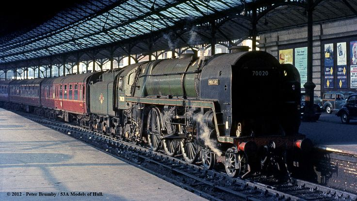 """British Railways Standard class 7P 4-6-2 70020 """"Mercury"""" at Euston having arrived with an express from the north - 10/03/1964. The Crewe built (1951) Pacific was new to Old Oak Common before moving to Cardiff Canton in 1956. It was transferred to the LMR in 1961. It was a Willesden (1A) locomotive at the time of this picture, but was withdrawn from Carlisle Kingmoor in January 1967."""