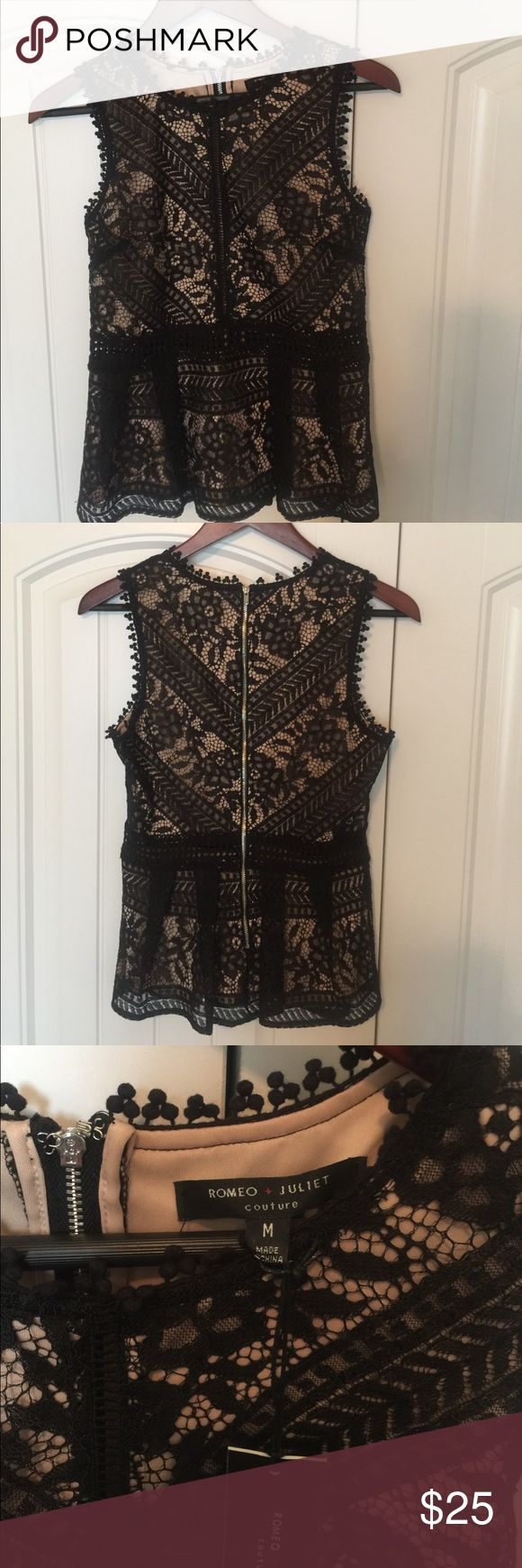 Romeo & Juliet Couture Lace top Black lace top by Romeo & Juliet Couture. Has nude cami behind the lace. Open cutout down the chest and around the waist that shows some skin ( shown in 4th pic).  Fitted through the body with a slight flare at the waist. Romeo & Juliet Couture Tops Blouses