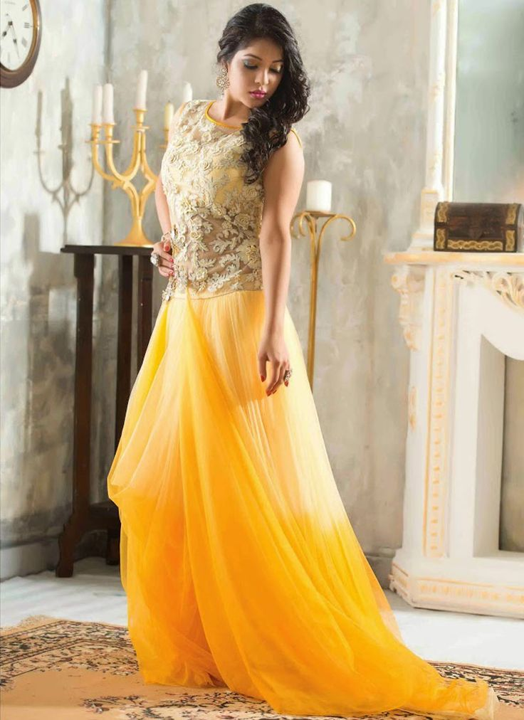 Glorious Golden Georgette With Net Designer Party Wear Gown http://www.angelnx.com/