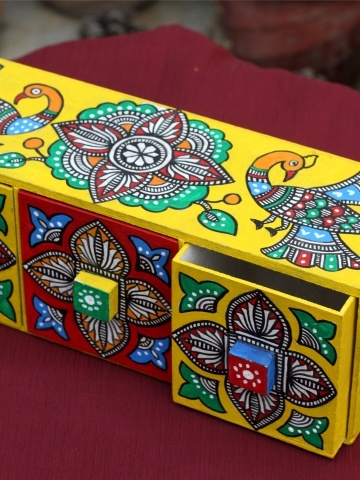 3 drawer jewellery box handpainted by our partner artist Heera Kant Devi of Bihar.    Approx Dimensions: H , L  , D  Material: MDF Board. Acrylic paints