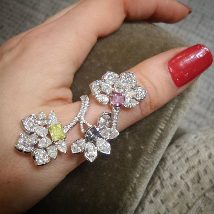 One of the most popular David Morris designs - Diamond full finger Blossom ring...and yes, that pink, blue and yellow stone is also a diamond! @davidmorrisjeweller
