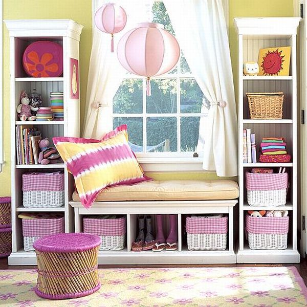 Great way to create a shelving unit and window seat: two upright cases and one bench, all with storage capacity.
