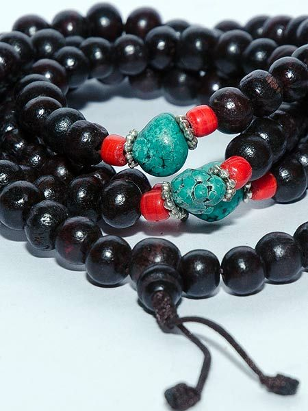 Red wood mala with powdered turquoise. 108 beads that are 8.5mm