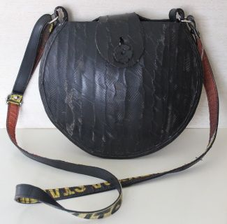 Coconut Bag // This coconut shaped bag is made from 100% recycled car tires. It has a hard exterior and long adjustable strap. Perfectly sized to fit all belongings and wear everyday.