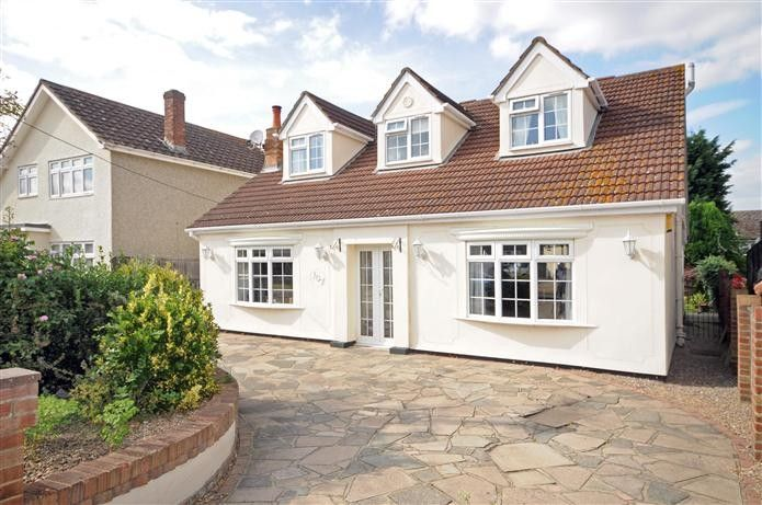 White Render on dormas and walss, red brick roof