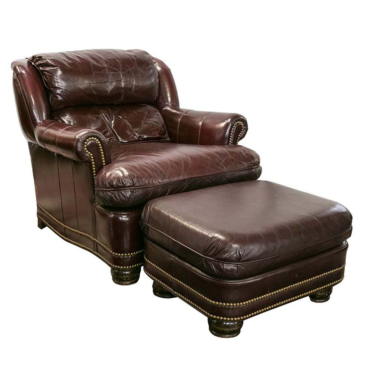 Traditional armchair and ottoman duo by Hancock and Moore