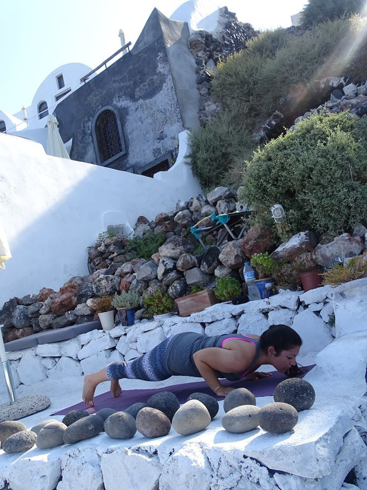 Yoga is the best way to start your day! Balance yourself under the sun and breathe the Mediterranean sea breeze. Santorini island, Greece. - Selected by www.oiamansion.com