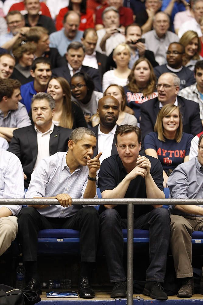 President Barack Obama and British Prime Minister David Cameron chat during one of the NCAA basketball tourney games at UD Arena in Dayton, Ohio 3/13/12. Photo by Ty Greenless/Dayton Daily News. #firstfour