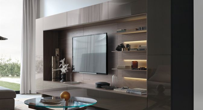 Designed and made in Italy, Open 13 wall and TV unit is a storage and aesthetics living solution. The back wall holds a mounted television or media unit, and hides cables and wires.