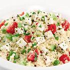 Een heerlijk recept: Couscous salade met kerstomaatjes en lente-ui