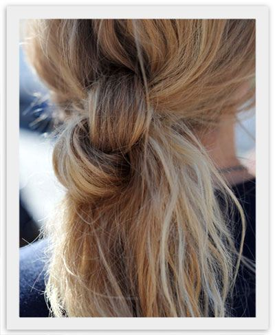 Easy Peasy. Can also secure underneath with a ponytail holder that matches the hair. Kind of shove it underneath the knot!!
