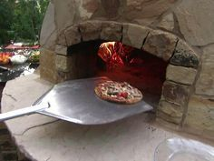 Shelf in front of opening . How to Build an Outdoor Pizza Oven : Outdoors : Home & Garden Television