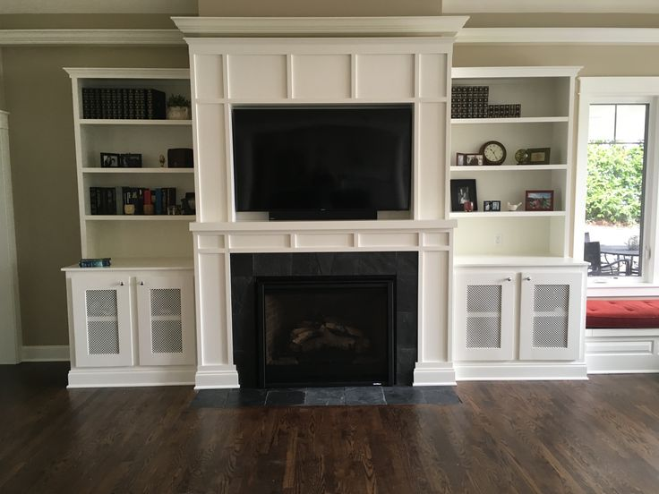 Craftsman inspired custom fireplace mantel and entertainment center.