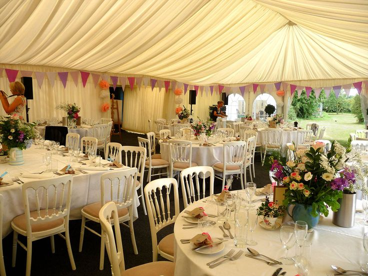 A vintage wedding theme in Stock, Essex. With jugs of wild flowers and old fashioned bunting completes the look.