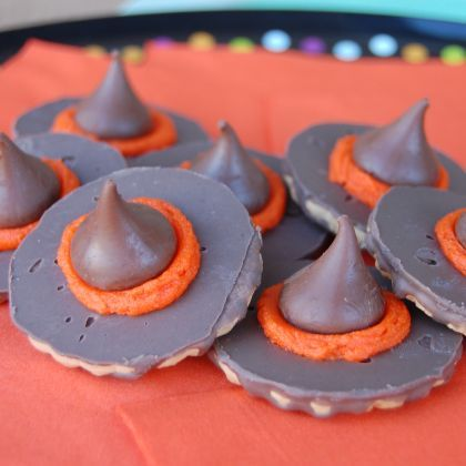 Witch Hat Cookies   Spoonful. I really don't know if I should pin this because I went off the recipe soo much but still this is where I got my inspiration. However I used york peppermint patties, and just barely melted the ends of the kisses on a hot pan instead of frosting. Cheaper and still looked adorable!
